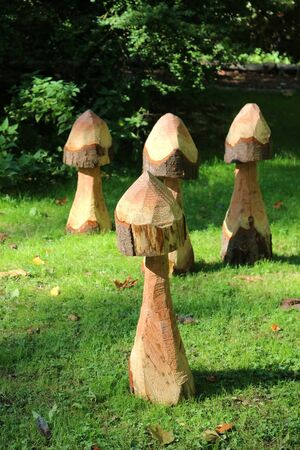 Mottisfont Abbey, Hampshire, England. 2nd October 2019. Wooden mushroom sculptures in the Mottisfont Abbey gardens. Фото со стока - 135344454