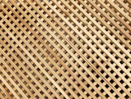 Close up of lattice wooden fence panels Фото со стока