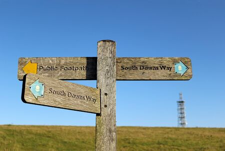 A signpost at the top of Butser Hill in Hampshire pointing to the South Downs Way