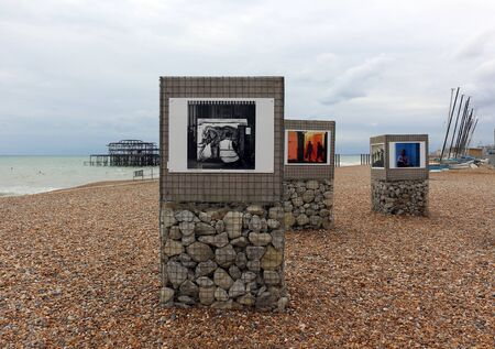 Brighton, East Sussex, England. 9th September 2019. Photographs displayed on the beach at Brighton Фото со стока - 135345271