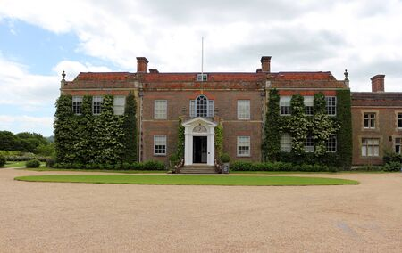 A view of the north side of Hinton Ampner House in Hampshire, England. Редакционное