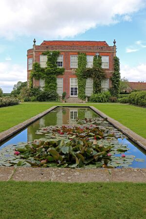Alresford, Hampshire, England. 17th June 2019. The house and pond at Hinton Ampner in Hampshire