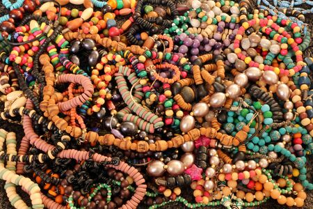 A pile of colourful handmade necklaces