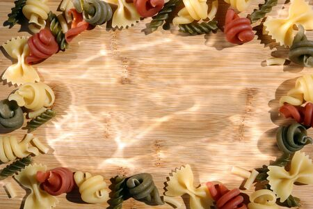 Multicolored Pasta Frame on a Wooden Background
