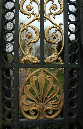 Elaborate florid design on a wrought iron gate