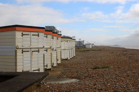 Worthing, West Sussex, England. 11th March 2020. A row of beach huts on Worthing beach.