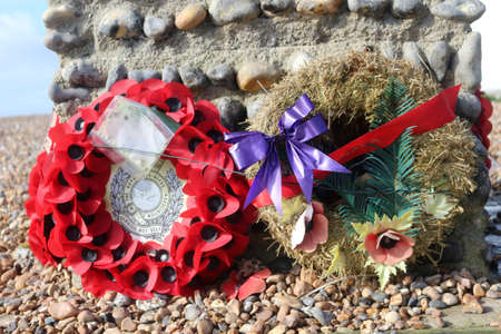 Worthing, West Sussex, England. 11th March 2020 .Wreaths left at the Canadian War Memorial on the seafront at Worthing.