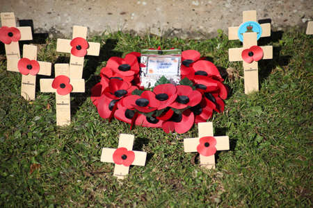 Rowlands Castle, Hampshire, England. 18th November 2019. A poppy wreath from the British Legion laid at the war memorial in Rowlands Castle.