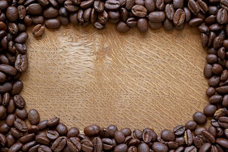 coffee beans border on wooden background