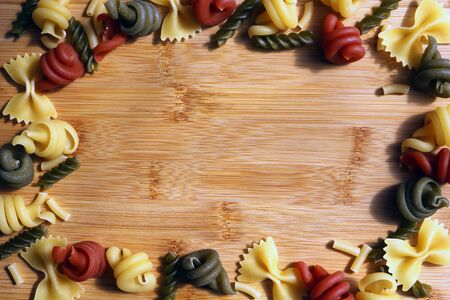 Colourful mixed dried pasta border Standard-Bild - 149978216