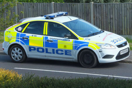 Portsmouth, Hampshire, England. 9th June 2013. A Hampshire constabulary police car parked on a curb.