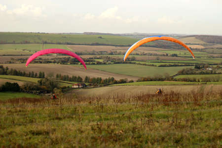 Butser Hill, Hampshire, England. 13th November 2019. Paragliders prepare for lift off from Butser Hill.