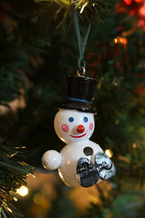 a one armed snowman on christmas tree