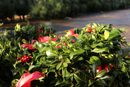 A pile of Christmas wreaths for sale outside