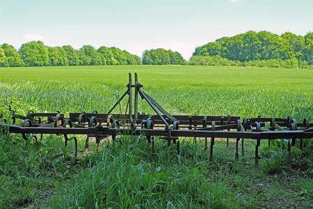 a plough in a green field