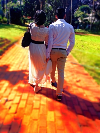wear: Couple walking at park Stock Photo