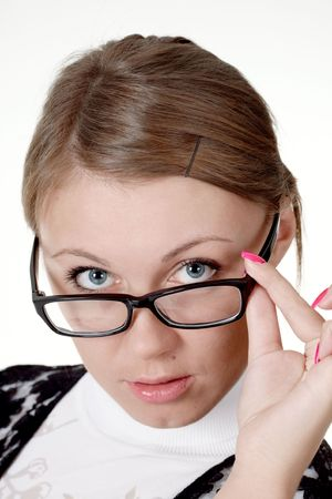 perplexing: Young woman staring over her spectacles. Close-up. Stock Photo