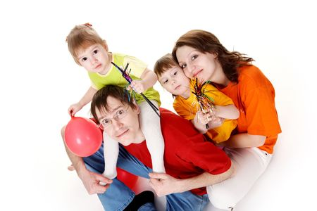 joyfully: family of four in colorful clothes. White background. Stock Photo