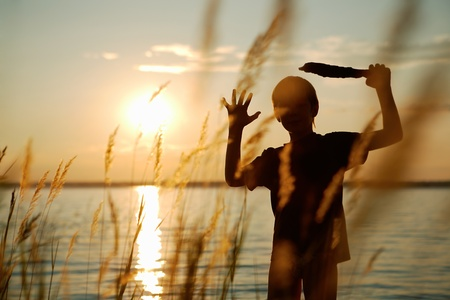 silhouette of a boy at sunset. summer landscape Stock Photo - 13137197