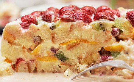 cookies and cream: cut of sponge cake with strawberries, peaches, pears and kiwi fruit