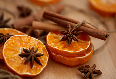 Spices and dried slices of tangerines for the manufacture of Christmas decoration