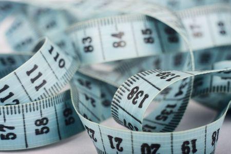tailor measure: blu centimetro sgualcito in una sfera