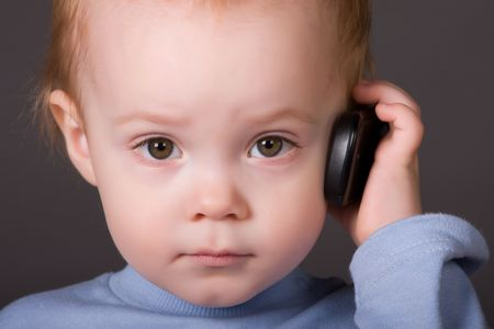 cellular telephone: child speaks on his cell phone