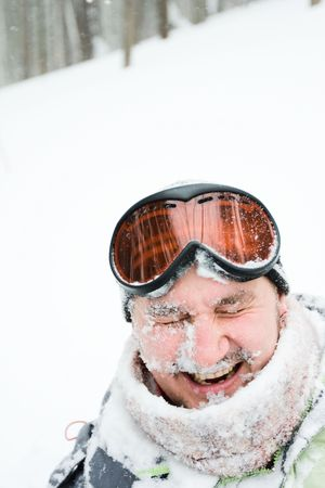 smiling guy with the snow on his face