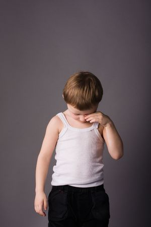 drowse: Little boy sad and in trouble Stock Photo