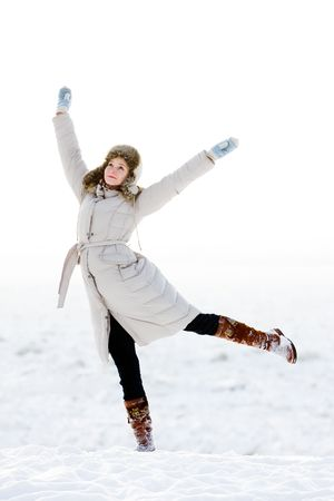 Dancing girl in winter on the bank of the river