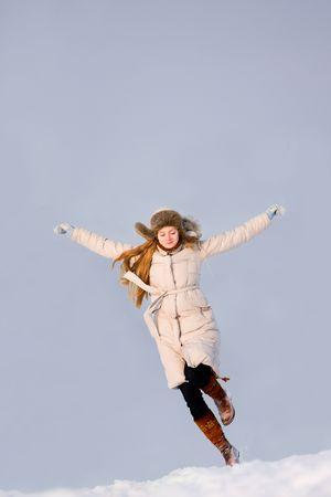 Running girl in winter photo