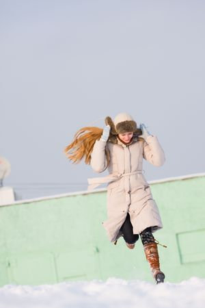 Running on the snow, which follows a girl hat