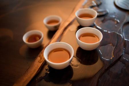 mug of tea stood around on the stand photo