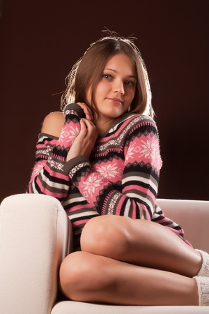 girl sitting on the couch to pull your knees Stock Photo - 8716115