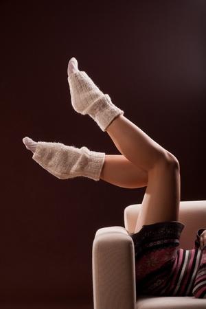 female legs wearing warm socks Stock Photo