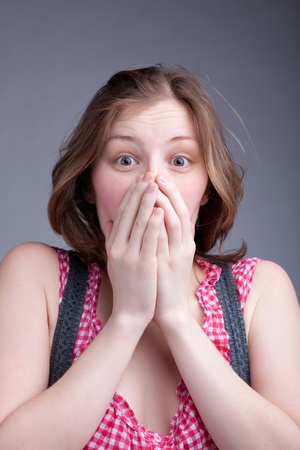 she covered her mouth with her hands Stock Photo