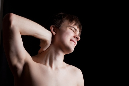 young person is experiencing pain in the neck