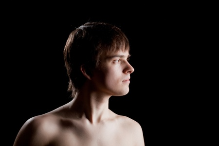 man profile: Profile of young man on a dark background