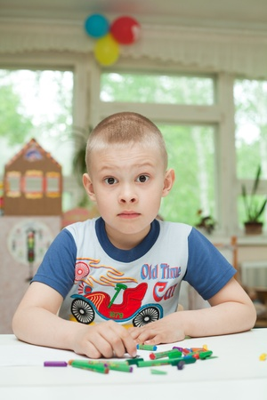 boy with crayons at the table Stock Photo - 9732336