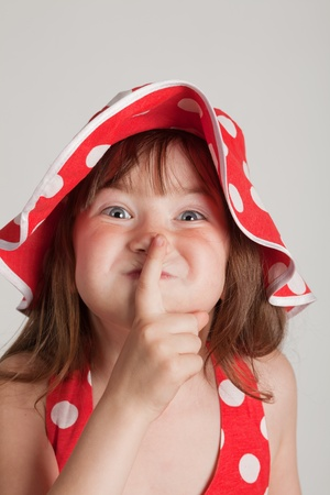 girl fooling around and point the finger to be quiet photo