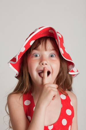 girl fooling around and point the finger to be quiet