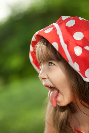 Girl in a red hat language shows Stock Photo - 9732412