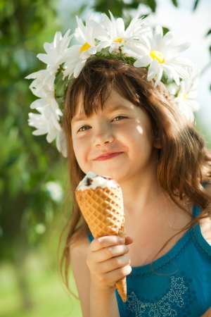 girl eating ice cream and looking at camera photo