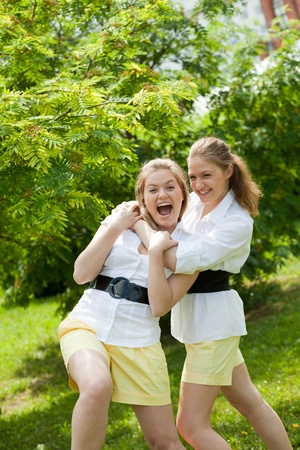 two sisters, twins hug each other photo