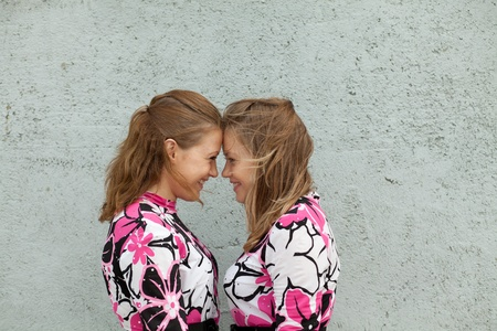 Twin girls standing face to face