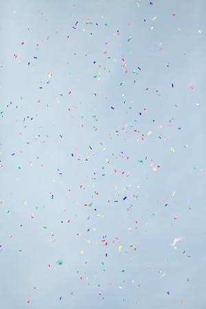 confetti on blue sky background
