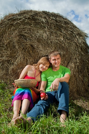 couple with apples sitting on the grass Stock Photo - 10233045