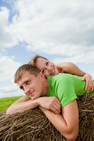 couple of young people lying on the hay photo