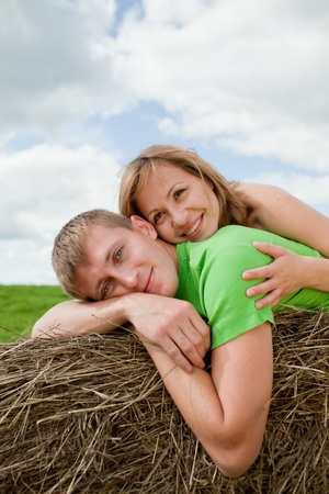couple of young people lying on the hay Stock Photo - 10233056
