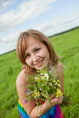 girl with a bouquet of wild flowers photo